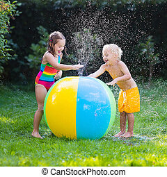 Kids playing with water ball toy - Child playing with toy...