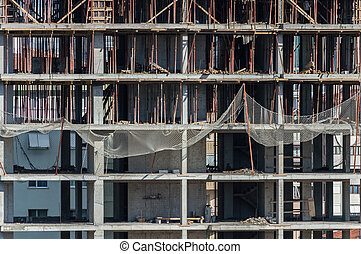 Frontal view of under construction building at construction site