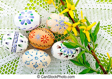 Easter Eggs And Yellow Blossom On The Tablecloth - taken...