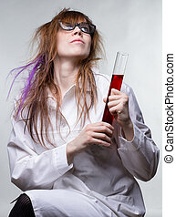 Scientist happy woman with results of searching on gray...
