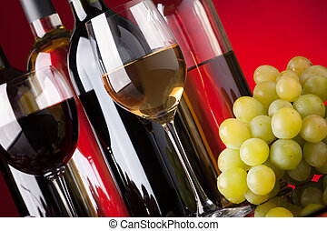 Bottles, glasses and grapes - Several bottles of red and...