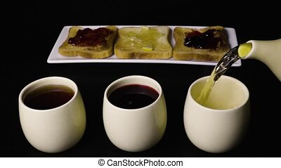 Super slow mo three kinds of tea and toast with jam three