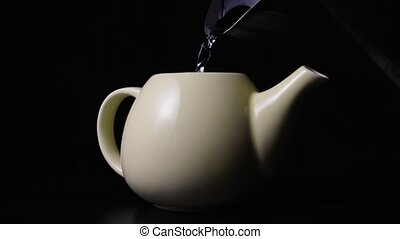 Super slow mo pouring boiling water into the teapot