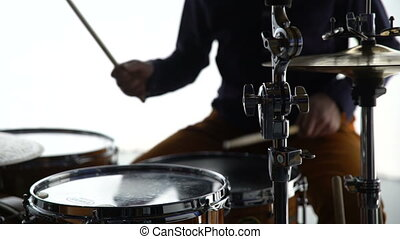 The drummer plays the drums. Medium Shot 4K