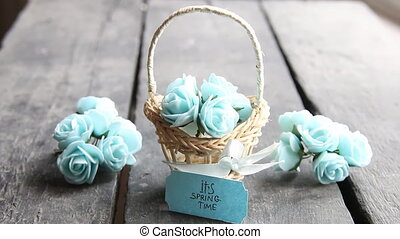 It's spring Time concept, flowers in a small basket -...