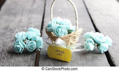 spring sale tag and flowers in a small basket - Bouquet of...