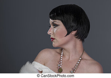 Flapper, 1920s style brunette dancer with short hair and...