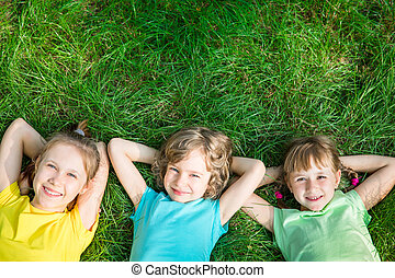 Group of happy children playing outdoors