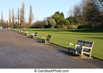 Hyde Park - Park benches and wide path in Hyde Park, London,...