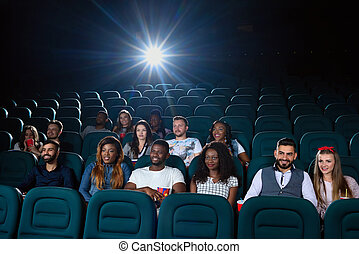 Group of multicultural friends at the movie theatre - Big...