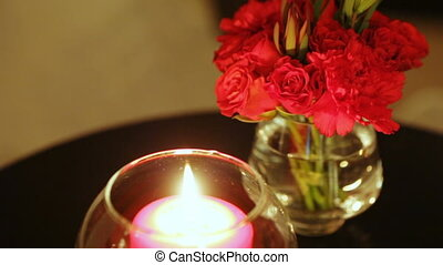 Candles in glass flasks - On the white marble steps are red...