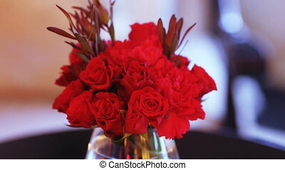 Red flowers on festive table - Decorating with red flowers...