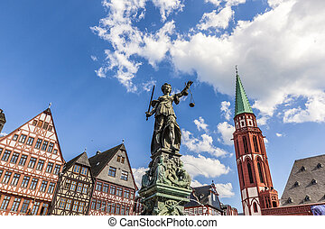 lady Justice at roemerberg in Frankfurt with half timbered...