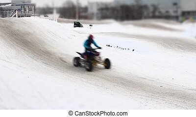 Winter motocross track during race tilt film