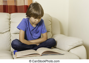 Kid reading a book at home
