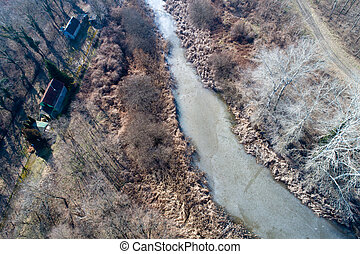 Winter landscape of frozen river from air - Landscape of...