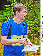sportsman on start of orienteering competitions - Portrait...