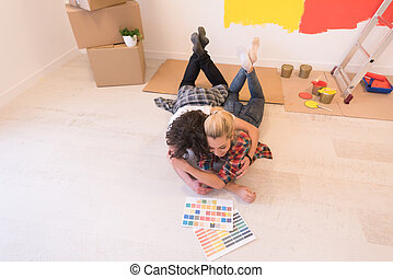 Happy young couple relaxing after painting