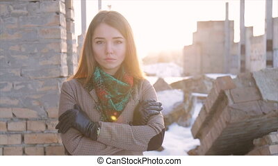 Girl in a plaid jacket on building background.