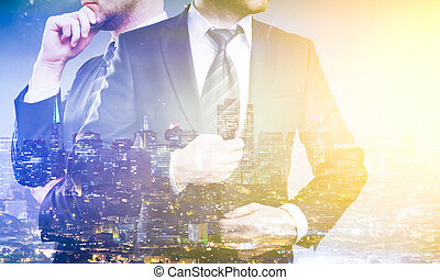 Businesspeople on city background - Two young thoughtful...