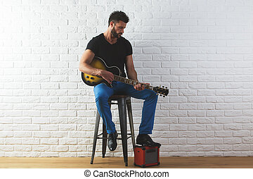 Musician concept - Attracive caucasian man in casual...