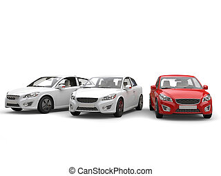 Modern family cars - red stands out among the white - studio...
