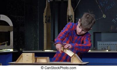 Boy builds a bridge - Boy 10 years building a bridge made of...