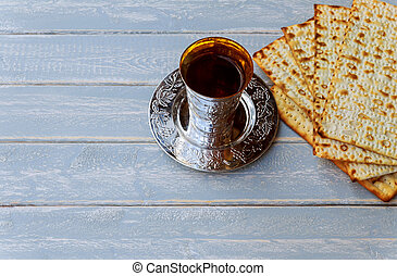 Red kosher wine with matzah or matza and a Passover Haggadah...