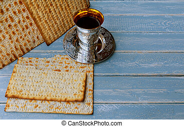 passover matzo with kiddush cup of wine wooden table -...