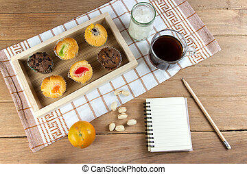 Cup cake various flavors in wood tray on wood table
