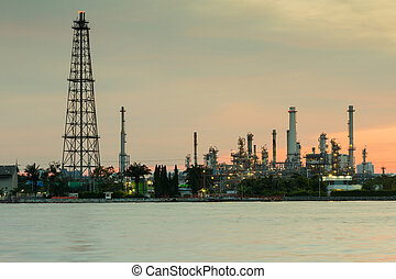 Oil refinery water front with sunrise sky background