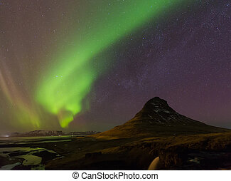 Northern light over Kirkjufell mountain with fully of star...