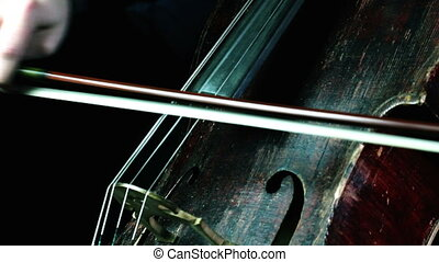 old wooden cello playing on a concert - retro red wood cello...