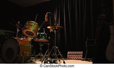 Woman percussion drummer performing with drums, slider, wide...