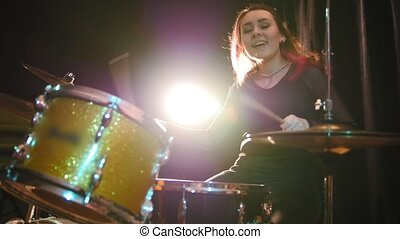 Teen rock music - gothic girl percussion drummer perform...