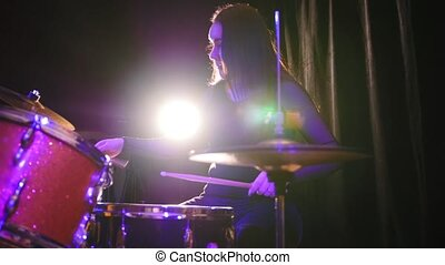 Teen rock music - gothic girl percussion drummer, slider,...