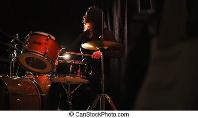 Emotional girl percussion drummer performing with drums,...