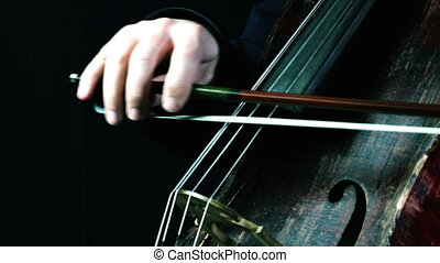 closeup of an old cello orchestral playing