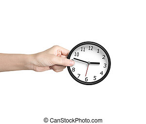Time is money concept. - Hand putting a black-white clock,...