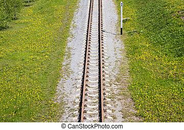 Rail road in green field
