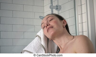 Woman wiping wet hairs after bathroom with blanket - Asian...