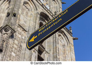 Tourist sign in front of the Martini church in Groningen,...