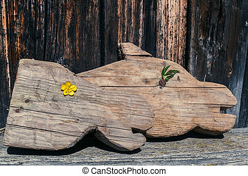 Retro image. Two old wooden carved horse's heads are laying...