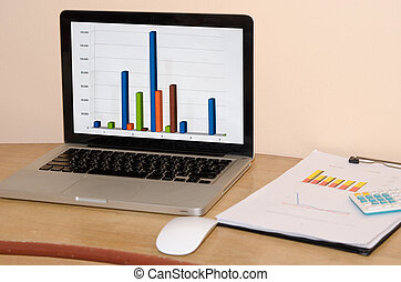 computer business graph - Computer with a business graph on...