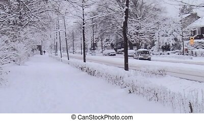 Heavy snow on the street in the city. - Snow on the road in...
