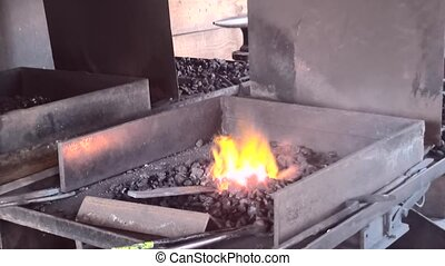 The blacksmith make iron warm to work with it - All the...