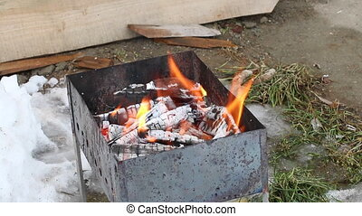 Brazier with burning wood in it. Hot coals are ready for...