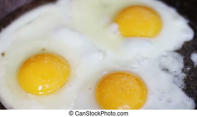 Cooking eggs in a frying pan.Top view. - Breakfast just...