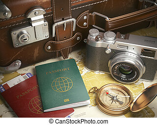Travel or turism background concept. Old suitcase, passports...