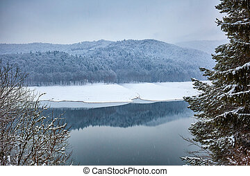 Mountain lake in winter time